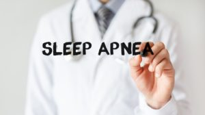 Doctor writing sleep apnea